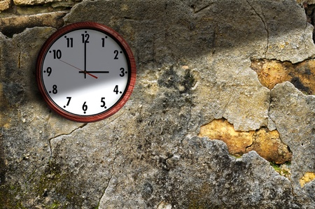 clock on the old wall cement in the late afternoon. Stock Photo