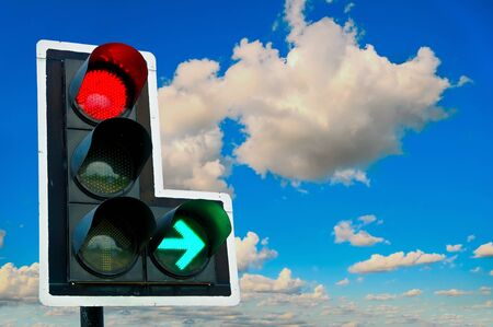 Traffic lights red and green on  blue sky background