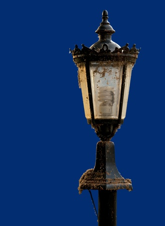An old street lamp isolated on a blue background. Stock Photo - 11308263