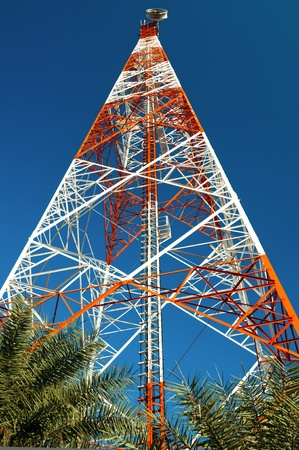 Telecommunication Tower witht a blue sky background. photo