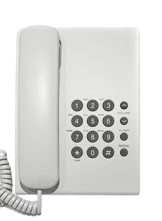 White office telephone on white background. photo