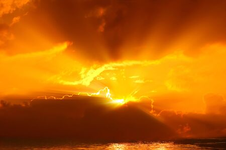 Beautiful sun rays on sky and cloud with water surface. Stock Photo