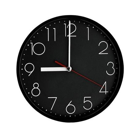 reloj de pared: Reloj de marco de pl�stico negro con n�meros ar�bigos.