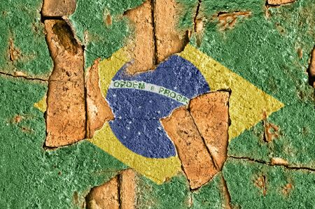 Flag of Brazil on the old wall cement