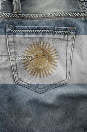 Jeans back pocket on pattern flag Argentina  Stock Photo