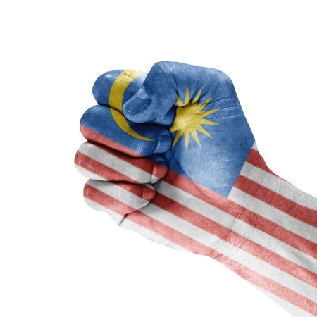 Malaysia flag on hand with clenched fist gesture over white background  Stock Photo