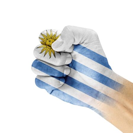 Uruguay flag on hand with clenched fist gesture over white background  photo