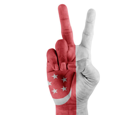 Singapore flag on hand of victory gesturing with white background