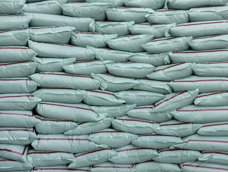 Plastic bags of fertilizer stacked layers. Stock Photo