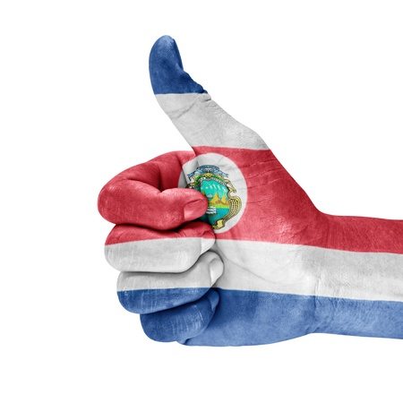 Costa Rica flag on thumbs up hand with white background. Stock Photo