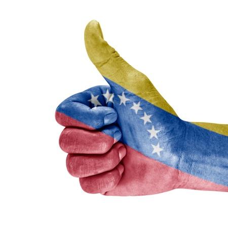 Venezuela  flag on thumb up hand with white background. photo
