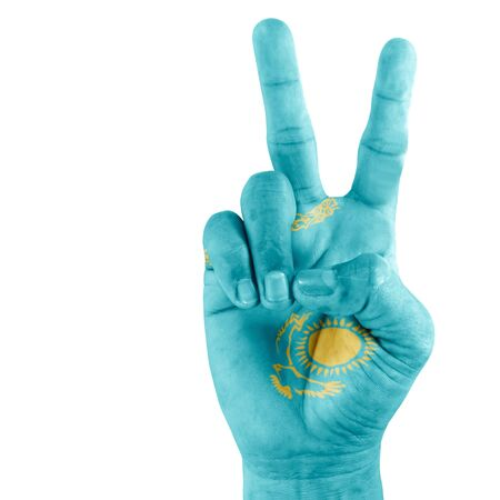 triumphant: Flag Of Kazakhstan on hand with clenched fist gesture over white background. Stock Photo
