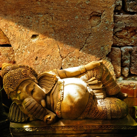 Ganesha statue on old wall background  photo