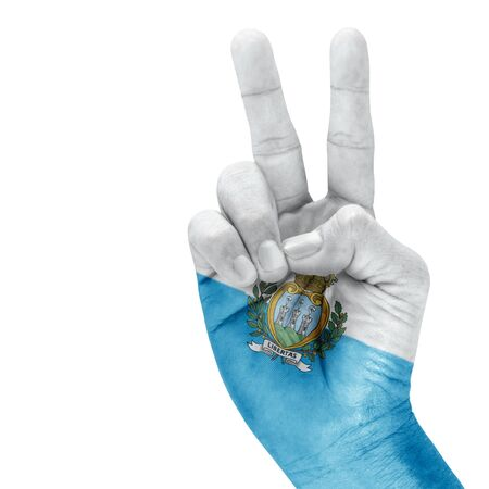 triumphant: Flag of San Marino on victory hand with a white background.