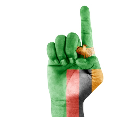 Zambia flag drawn on pointing up hand gesture with white background.