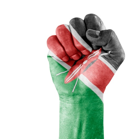 Flag Of Kenya on hand with clenched fist gesture over white background. photo