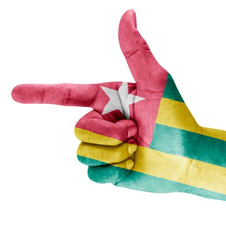 Togo flag drawn on shooting hand gesture with white background. photo