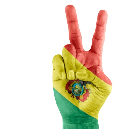 Bolivia (state) flag  on victory hand with a white background. Stock Photo