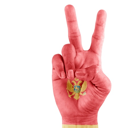 Montenegro flag  on victory hand with a white background.