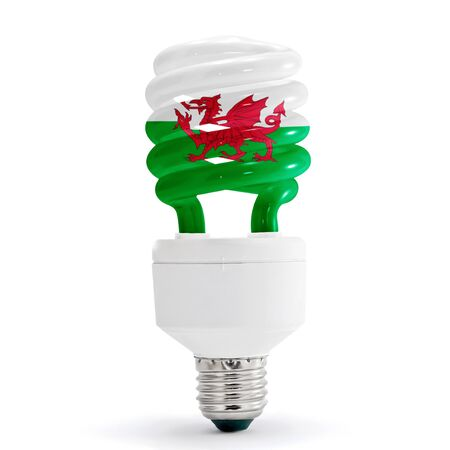 Flag of Wales with energy saving lamp on white background.