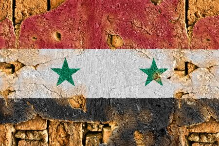 Grunge flag of Syria on old wall background.