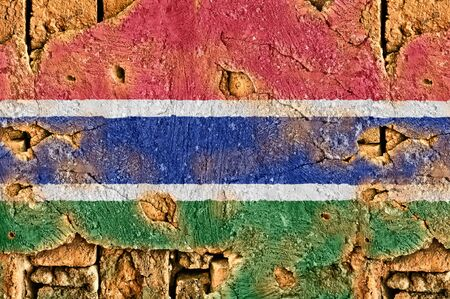 Grunge flag of Gambia on old wall background.