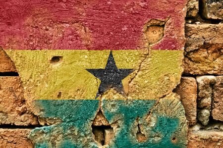 Grunge flag of Ghana on old wall background.