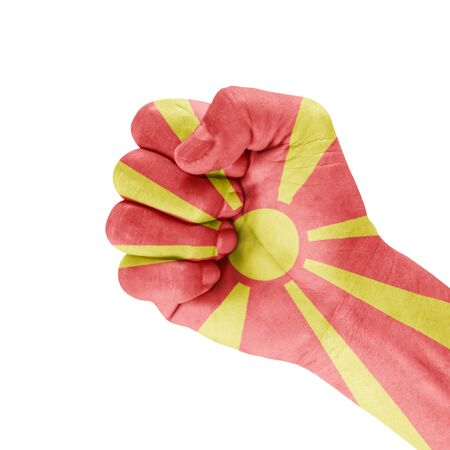 Flag Of Macedonia on hand with clenched fist gesture over white background. Stock Photo