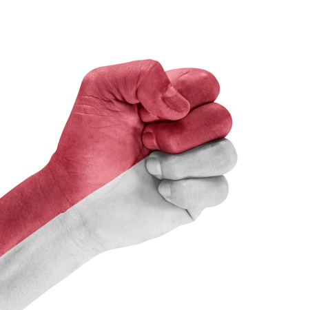 Flag Of Indonesia on hand with clenched fist gesture over white background. Stock Photo