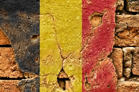 Grunge flag of Belgium  on old wall background.