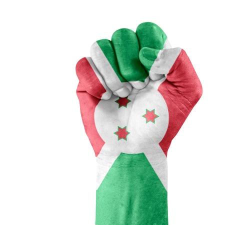 Flag of Burundi on hand with clenched fist gesture over white background  Stock Photo