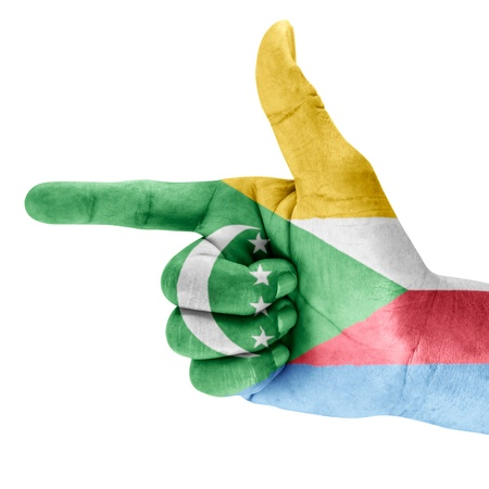 Flag of the Comoros drawn on shooting hand gesture with white background  photo