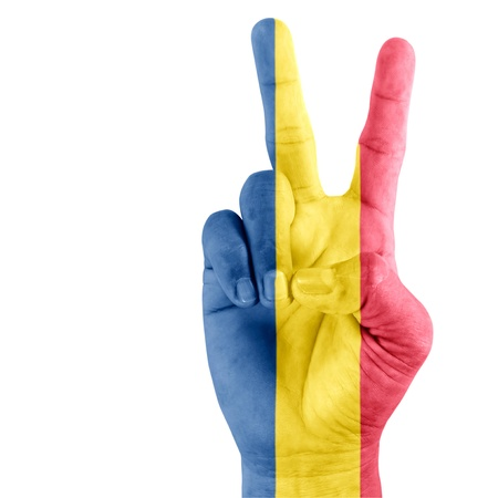 Flag of Chad on hand of victory gesturing with white background