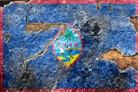 guam: Grunge flag of Guam on old wall background