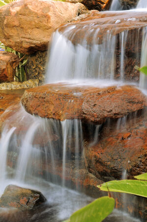 Small waterfalls on the rocks brown  Stock Photo