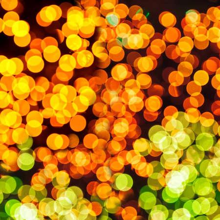 Bokeh lights yellow and orange background.