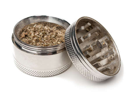 grinder: A marijuana grinder filled with weed Stock Photo