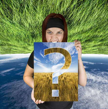 aggresive: Redhead girl holding a canvas with a question mark.Shot in studio. Composite background. Stock Photo