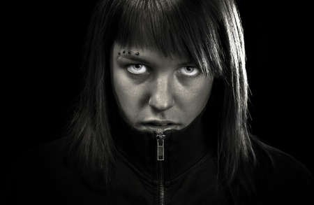 egoistic: Angry girl looking straight to camera. Determined and confident. Stock Photo