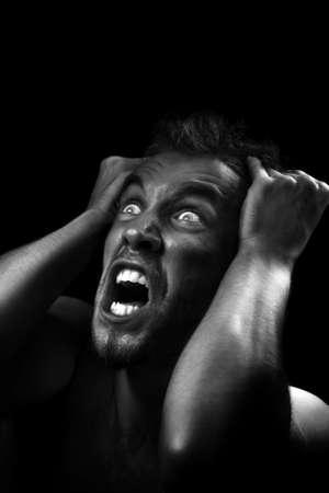 desperation: Studio shot converted in black and white. Human emotion of desperation.
