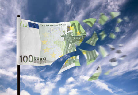 An euro banknote paper money falling into pieces in the wind.