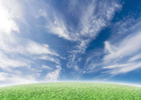 Beautiful nature background with green grass and blue vivid sky with clouds. Stock Photo - 2296938
