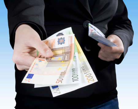 Hand passing Euro money banknotes of 50, 100 and 200 Euros. Stock Photo