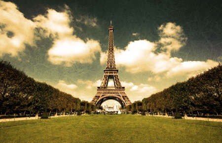Grunge sepia photo of the Eiffel tower in Paris with washed out textures and wide angle central perspective.