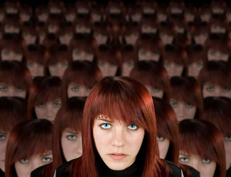 clones: Beautiful redhead girl with piercing and hundred clones staring at camera.