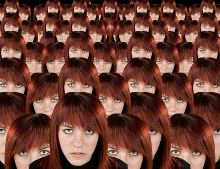 Beautiful redhead girl clones with piercing staring at camera. photo