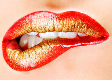 Bright fashion golden-red make-up of human lips Stock Photo - 3677198