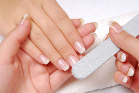 manicure: Studio nail — beautician polishing female nails