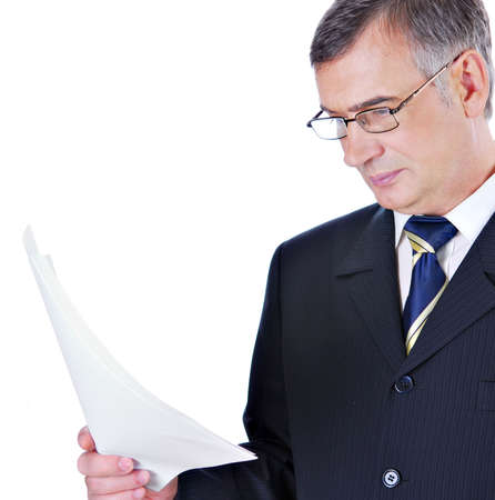 Businessman in suit and glasses reading Stock Photo - 3704233