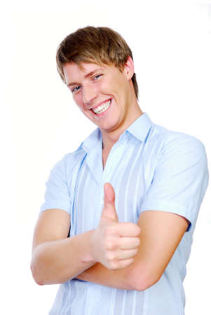 Cheerful  young adult male teenager showing the thumb of human hand Stock Photo - 3701788